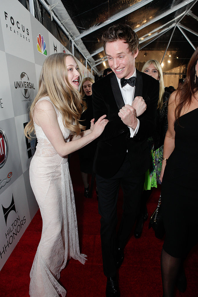 Amanda Seyfried and Eddie Redmayne joked around while heading into the Golden Globes after party.