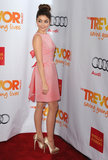 At the 2012 Trevor Live event in LA, Sarah Hyland chose a darling bow-back pink dress with gold satin platform pumps. A surprising back design is always welcome, especially on Valentine's Day.