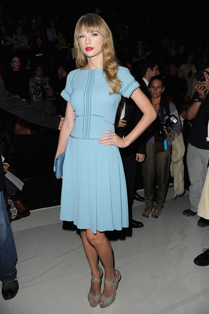 Taylor Swift, in a pale-blue creation and nude peep-toe pumps, sent photographers into a frenzy with her front-row appearance at Elie Saab at Paris Fashion Week.
