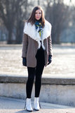 A shearling collar warmed up a bright top — then we got a cooler finish with white booties. Source: Adam Katz Sinding