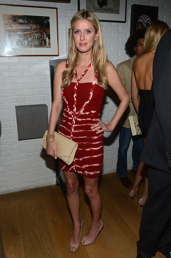 Nicky Hilton's detailed red dress was toned down, thanks to her nude clutch and matching peep-toes. Find an equally bold dress, then bring it down to earth with neutral accessories.
