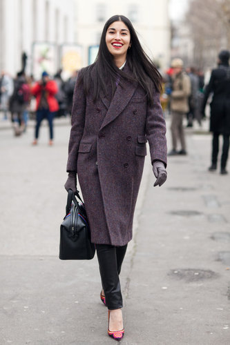 Caroline Issa showed off a covetable bit of menswear-inspired outerwear, then countered with ultrafeminine footwear. Source: Adam Katz Sinding