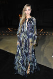 Cara Delevingne wore a floor-length printed and semi-sheer gown to the Carine Roitfeld for MAC party in Paris.