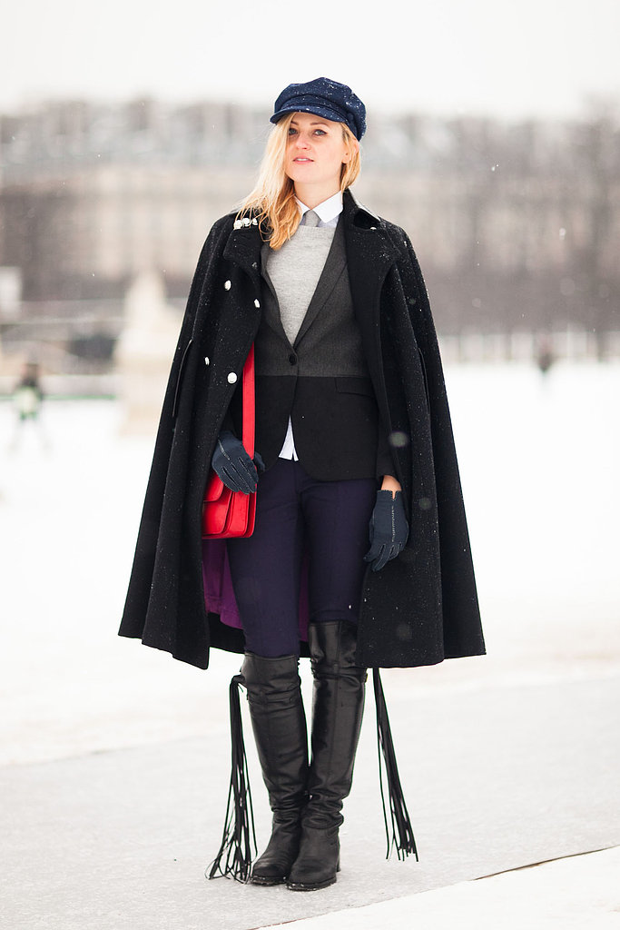 A newsboy cap, tailored coat, and bright bag took the focus in this tomboy mix-up. Source: Adam Katz Sinding