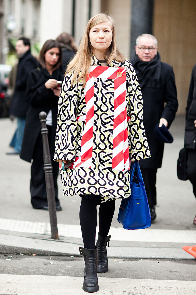 Bold patterns were made to play together, just be sure to temper their potency with a pair of black tights and staple boots. Source: Adam Katz Sinding