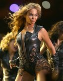 Beyoncé removed her cropped motorcycle jacket to show off the body-flaunting bodysuit.