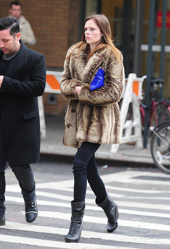 Even while strolling Manhattan, it's obvious Coco Rocha is a supermodel — those legs, that gorgeous coat, and the styled pop of blue on her arm.