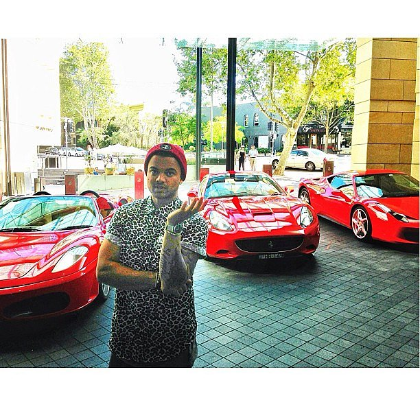 Guy Sebastian looked good in front of an army of sexy red cars. Source: Instagram user guysebastian