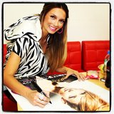 Ricki-Lee signed lots of posters for fans in Japan. Source: Instagram user therickilee
