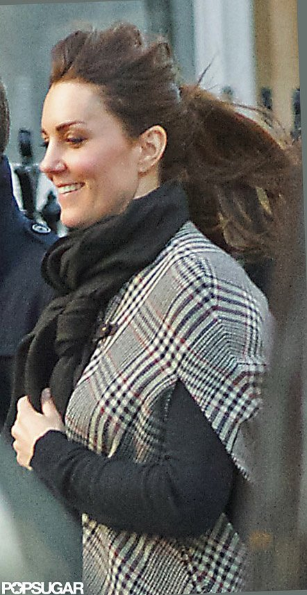 Kate Middleton wore a plaid cape.  Source: Topstar Pictures