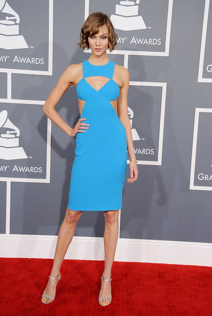 Karlie Kloss showed off her figure in a fitted blue dress.