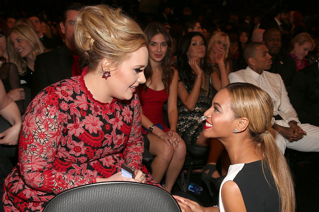 Beyoncé took a knee to chat with Adele during the 2013 Grammys on Sunday night.
