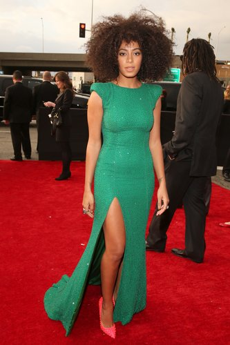 Solange Knowles showed off her leg in a green gown with a high slit for t