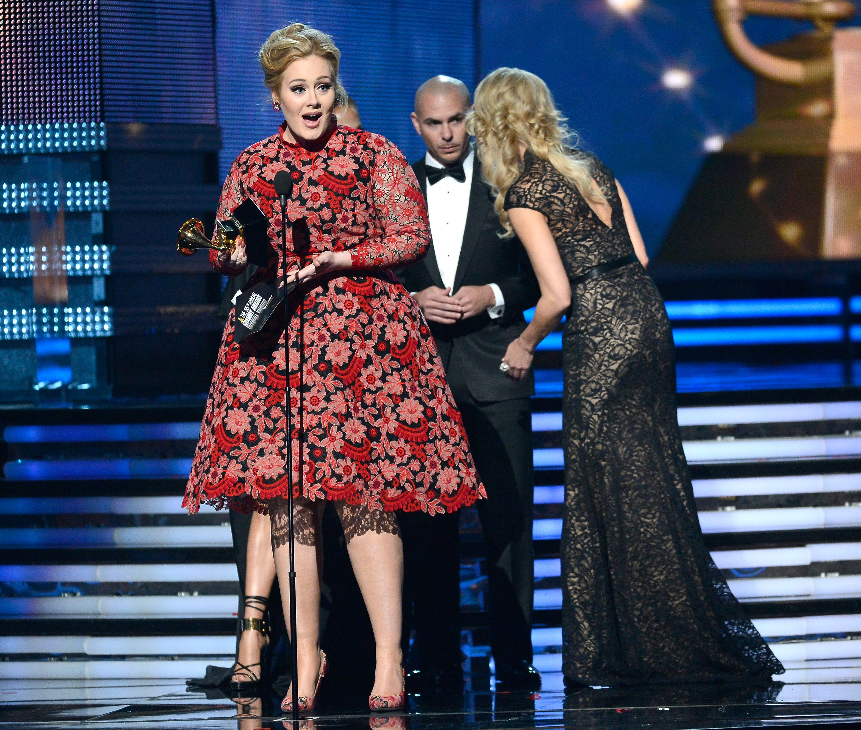 Adele stepped up to accept her award Sunday night at the 2013 Grammys in LA.