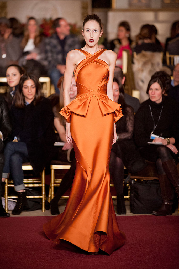 We'd love to see this rust-colored Zac Posen peplum gown on Oscar nominee Jessica Chastain — how great would it look against her pale skin and red hair?