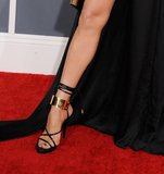 Jennifer Lopez's black Anthony Vaccarello gown was amazing on its own, but her gold-and-black strappy Tom Ford heels were just as mesmerizing.