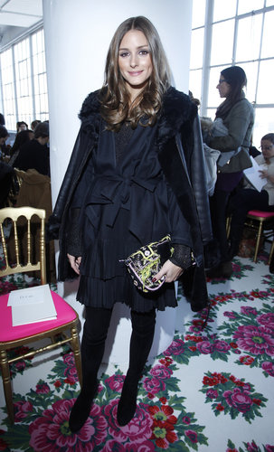 Olivia Palermo's neon clutch livened up her navy getup at the Joanna Mastroianni show.