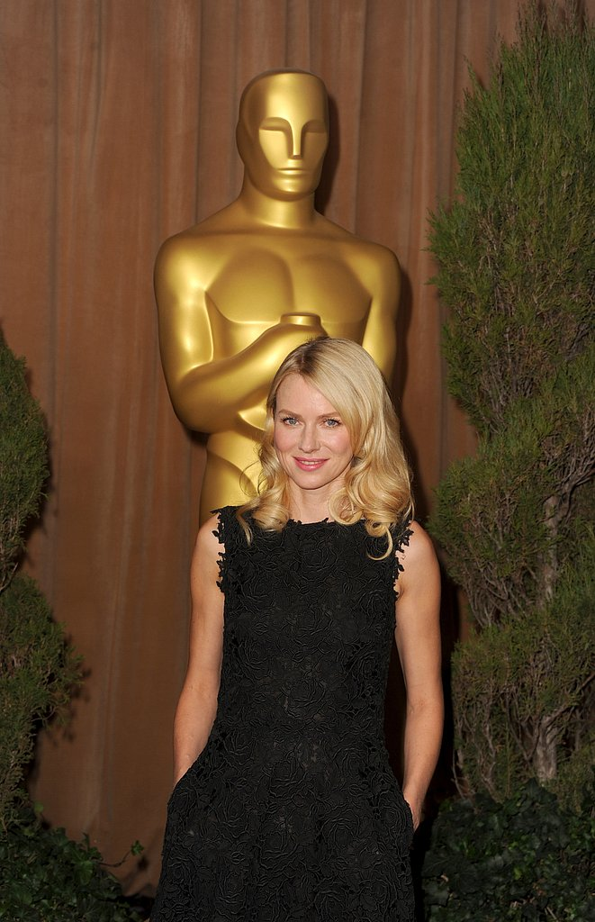 Naomi Watts tucked her hands in her pocketed black dress on the red carpet at the Oscars luncheon on Monday.
