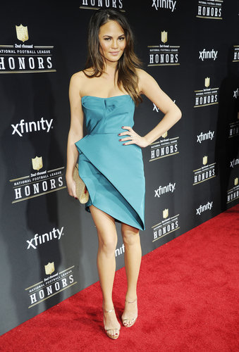 Chrissy Teigen wore a teal asymmetrical dress to the NFL Honors ceremony Saturday night in New Orleans.
