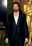 Hugh Jackson wore a midnight blue suit to the 2013 Oscars luncheon in Beverly Hills.