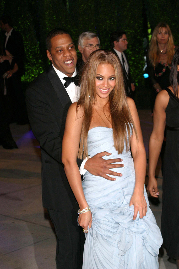 Jay Z held onto Beyoncé as they made their way to the Vanity Fair Oscars afterparty in February 2005.