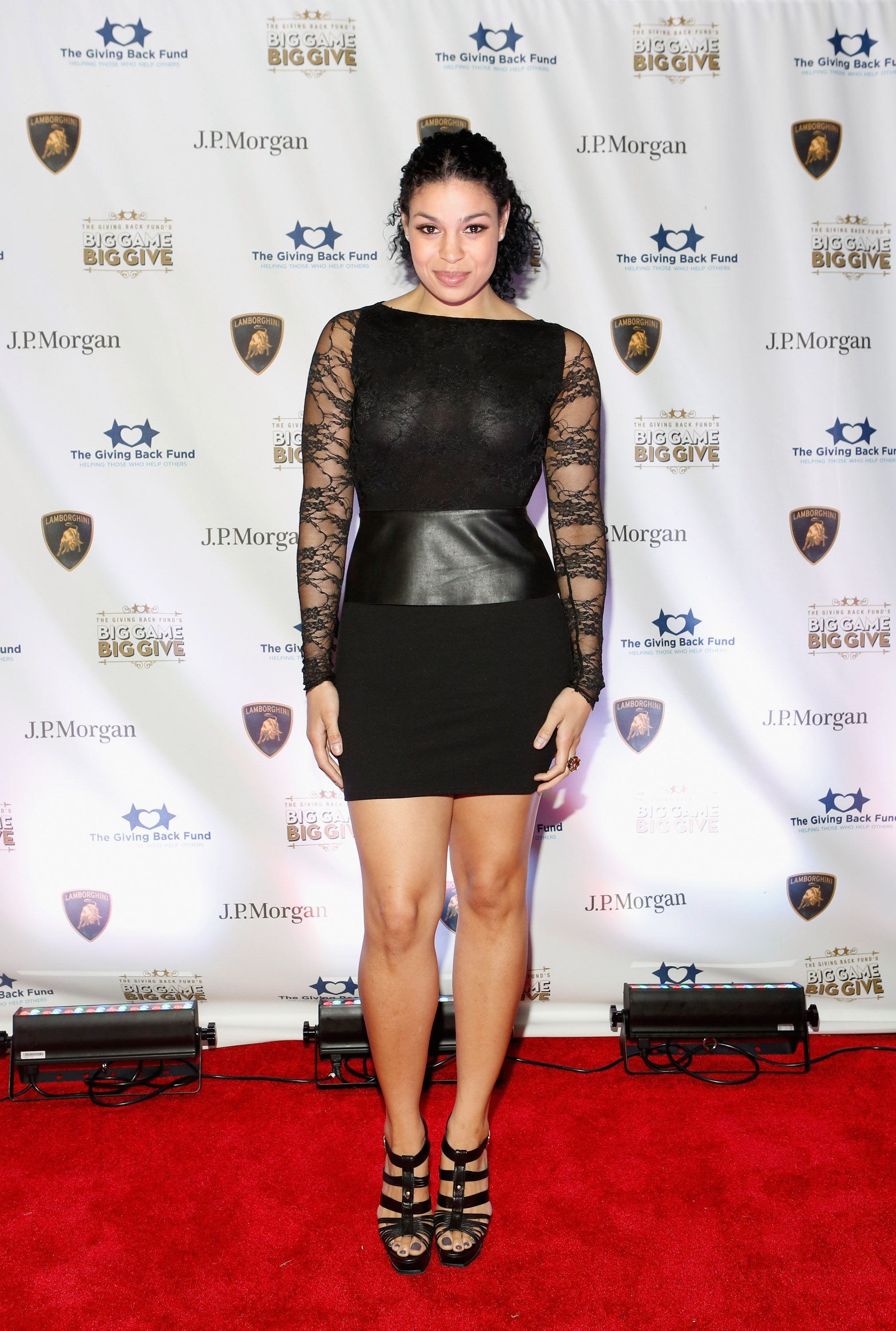 Jordin Sparks chose a LBD with serious mixed-media intrigue at The Giving Back Fund's fourth annual Super Bowl celebration. Just look to the long lace sleev