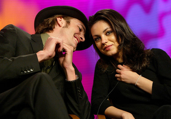 Ashton Kutcher whispered in Mila Kunis's ear during the FOX Television Critics Association press tour in January 2004 in Hollywood.