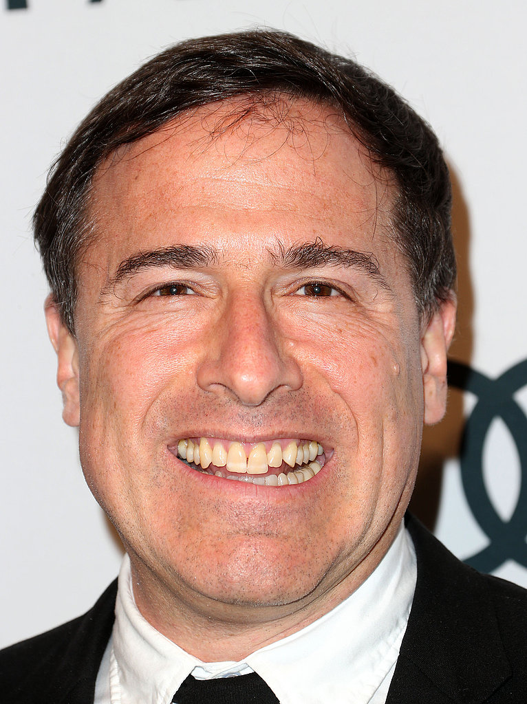 David O. Russell smiled on the red carpet.