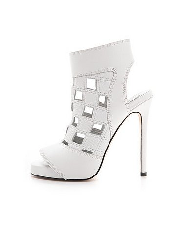 We love the cool checkerboard-inspired cutouts on Camilla Skovgaard's Caged Cutout Sandals ($610).