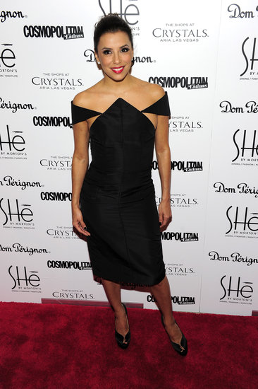 At the grand opening of SHe in Las Vegas, Eva Longoria stunned in a black off-shoulder Cushnie et Ochs dress and peep-toe Charlotte Olympia pumps.