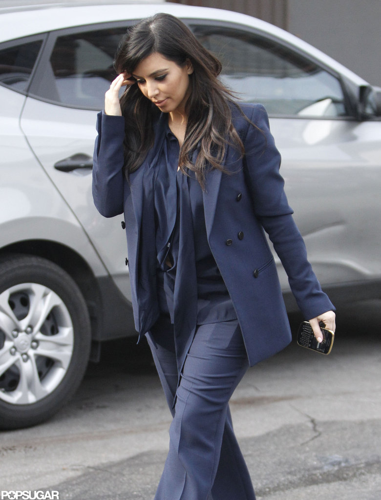 Kim Kardashian covered her baby bump with a blazer.