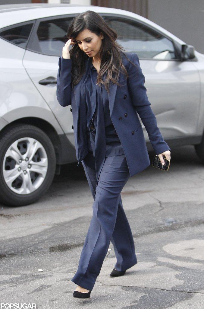 Pregnant Kim Kardashian wore a navy suit.