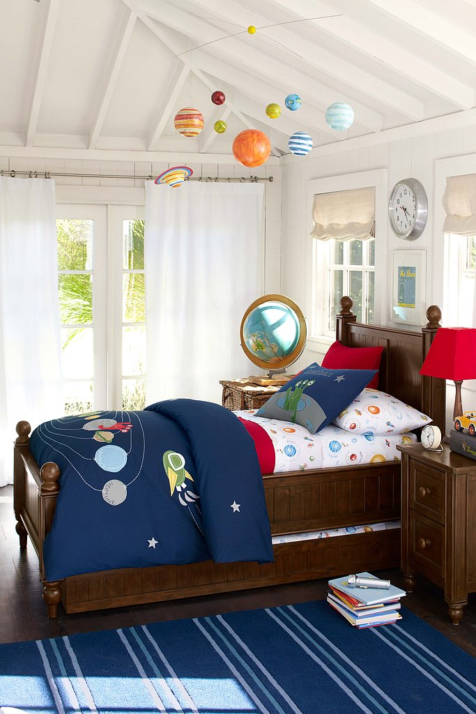 Your big boy's room may already be the final frontier when it comes to keeping a clean house, and now it can look like that even when it's clean. We love the new Nathan bedding collection complete with planets, stars, and even the requisite alien. Wha