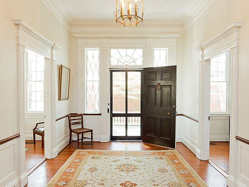Like Noah's house, this property maintains a lot of the original architecture. The ornate trim gives it a traditional style, while beautiful windows line the entryway, allowing in plenty of natural light. Source: Sotheby's