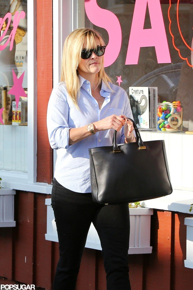 Reese Witherspoon wore a blue button-down with black pants for a lunch outing.