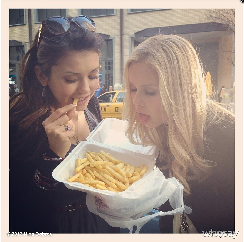 Nina Dobrev showed off a wristful of bangles while eating French fries with a friend. Source: Nina Dobrev on WhoSay