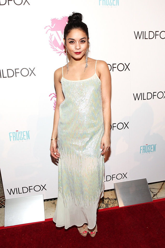 Donning a sequin embellished maxi, chandelier earrings, and a top-knot bun, Vanessa Hudgens was the epitome of bohemian-chic at the Wildfox show.