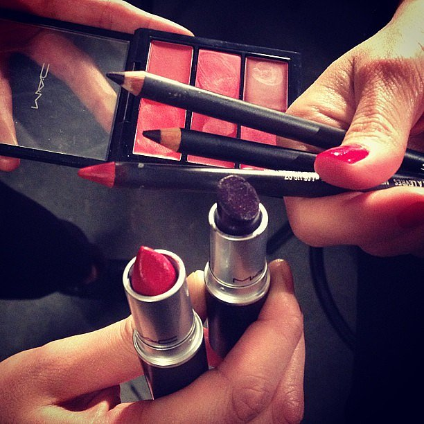 The products behind the makeup look at Kenneth Cole. We spy Ruby Woo by MAC Cosmetics.