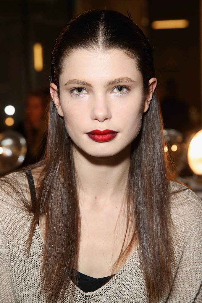 We couldn't get enough of the ombré red lip at Kenneth Cole Collection, which was created using black eyeliner as lip liner.