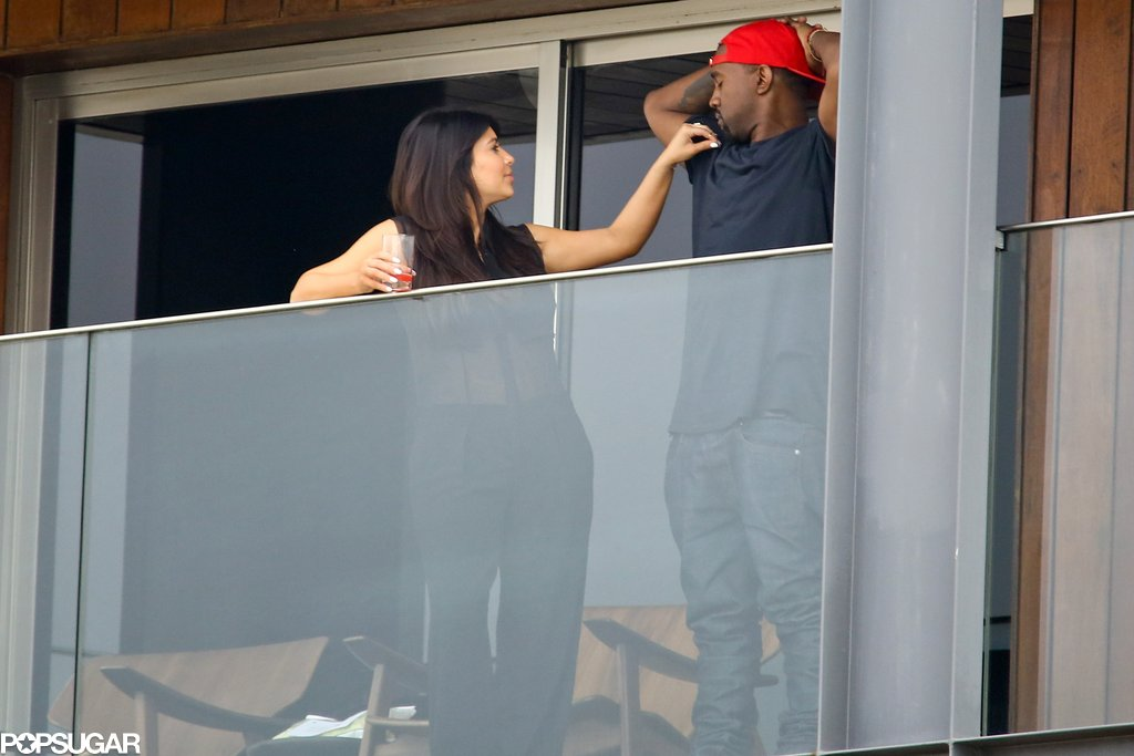 Kim Kardashian and Kanye West hung out on the balcony of their Rio hotel.