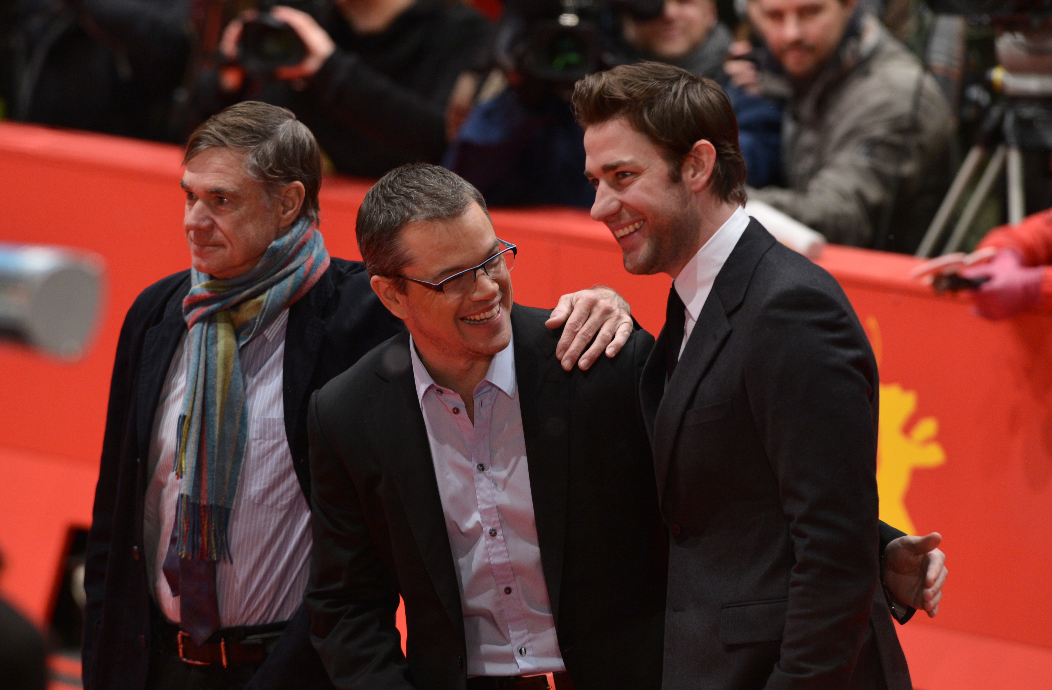 Matt Damon laughed with co-writer John Krasinski as they posed for a picture with Promised Land director Gus Van Sant.