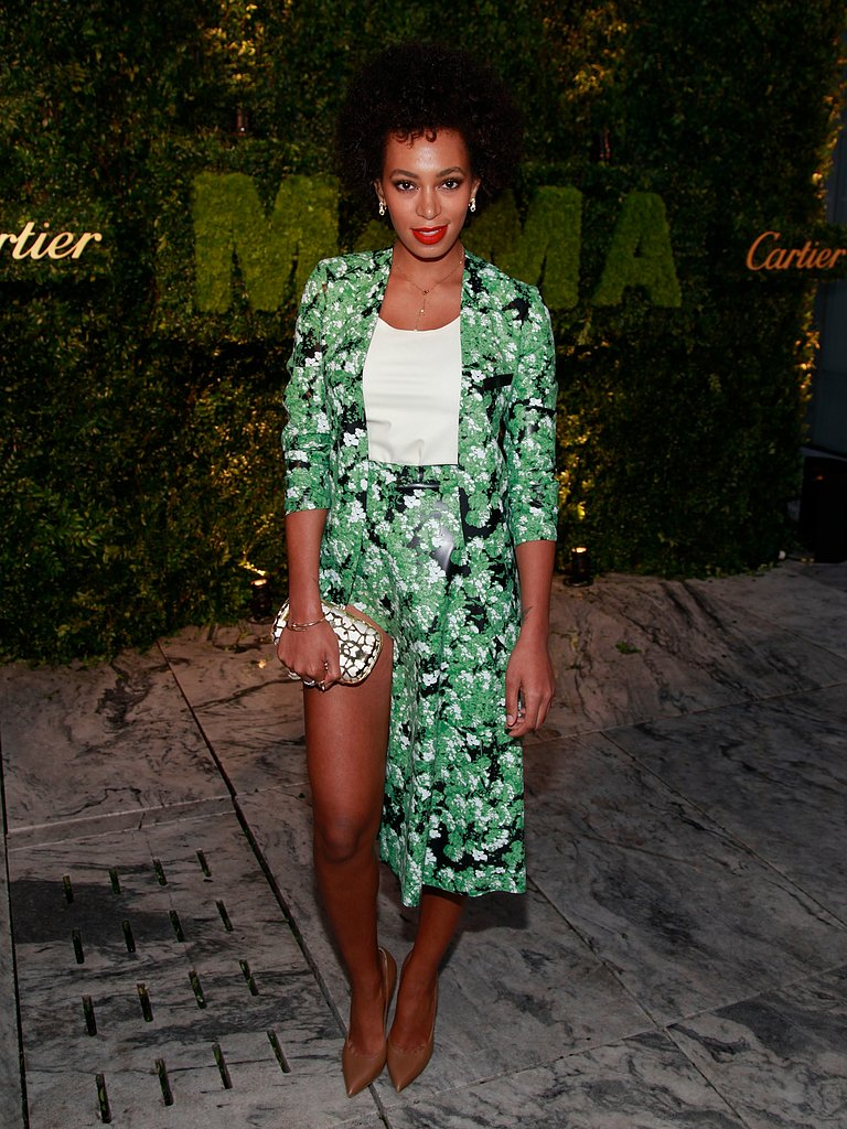 Solange took the high-low trend to new heights, donning a green garden-print, leg-baring combo by Flaminia Saccucci with nude pumps and a mirrored box clutch at a MoMA benefit in NYC.