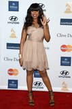 Jennifer Hudson accessorized her beige chiffon confection with ankle-wrap sandals and a dazzling cuff.