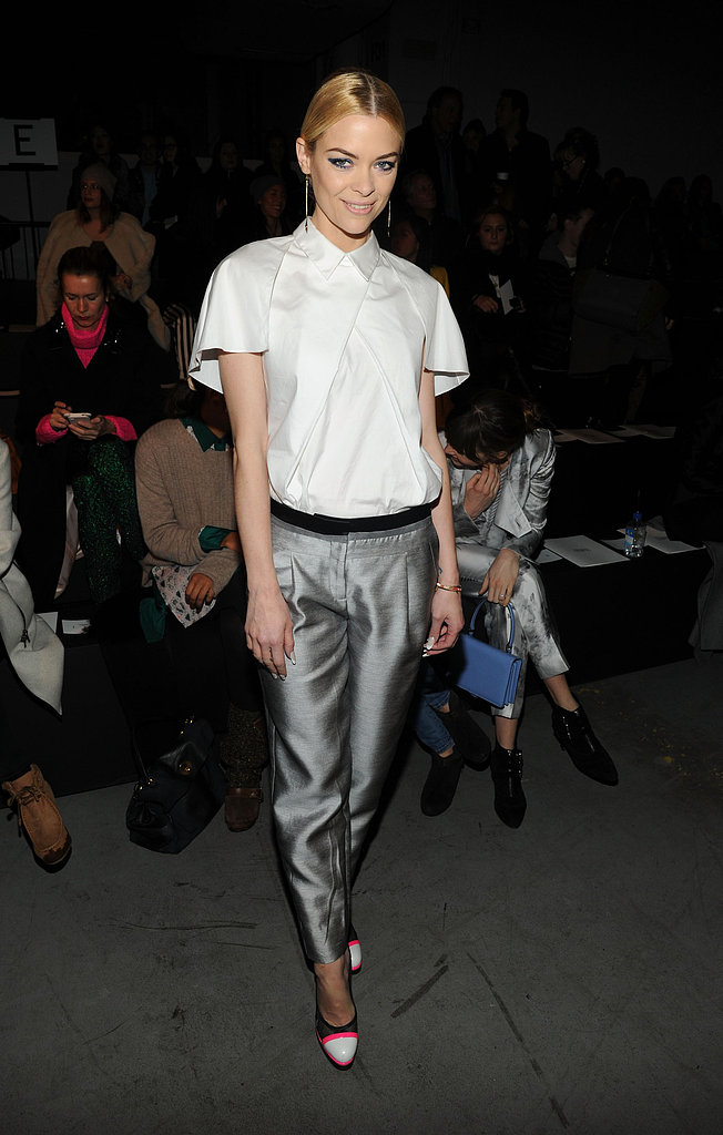 Jaime King posed at Prabal Gurung in silver metallic trousers, a short-sleeved collared blouse, and neon-infused cap-toe pumps.