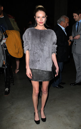 Kate Bosworth looked part cosy, part glitzy in a fuzzy grey sweater, a sequined miniskirt, and black pumps at the Topshop Unique fashion show.
