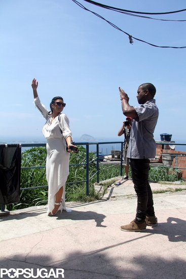 Kim Kardashian posed while Kanye West snapped pictures of her in Brazil.