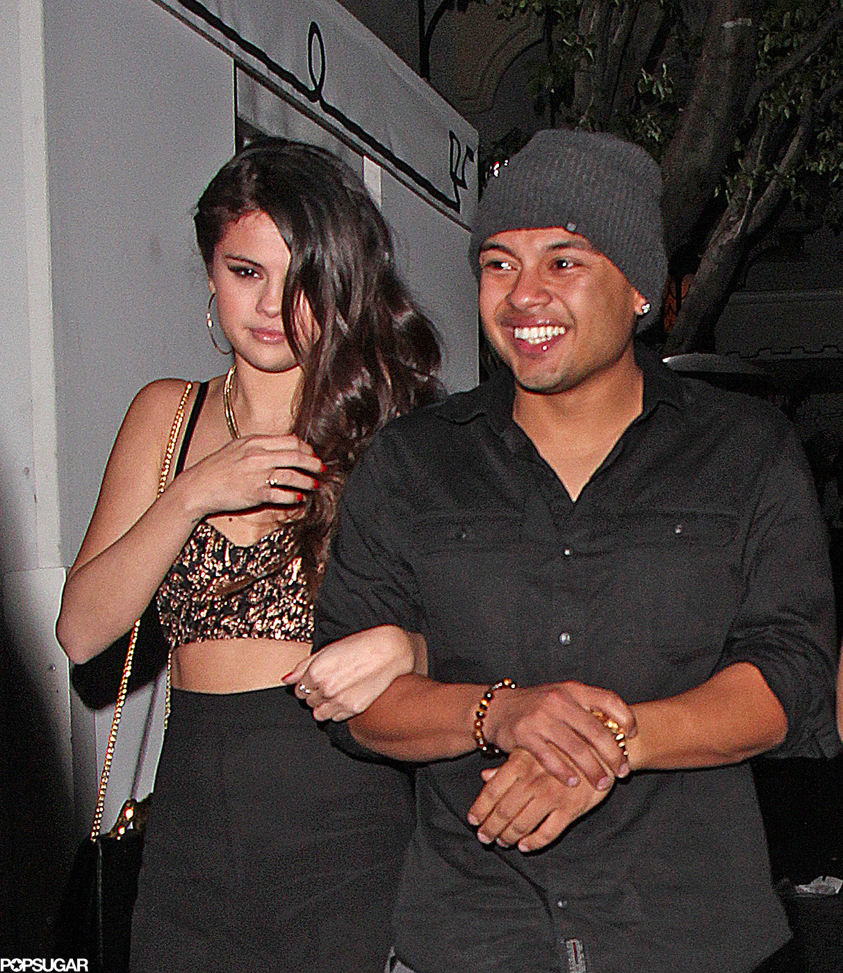 Selena Gomez left a Grammys afterparty on the arm of director Alfredo Flores.