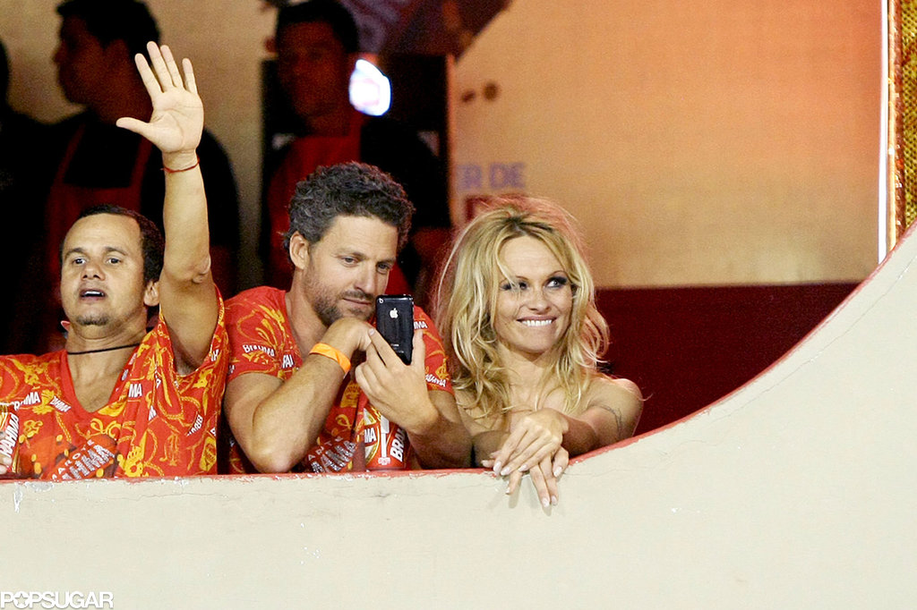 Pamela Anderson was joined by a mystery man in February 2011 during the Brahma party as she watched the carnival in Rio De Janeiro.