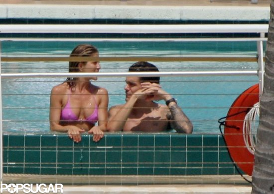 Jennifer Aniston chatted with then-boyfriend John Mayer in a Miami pool in May 2008.