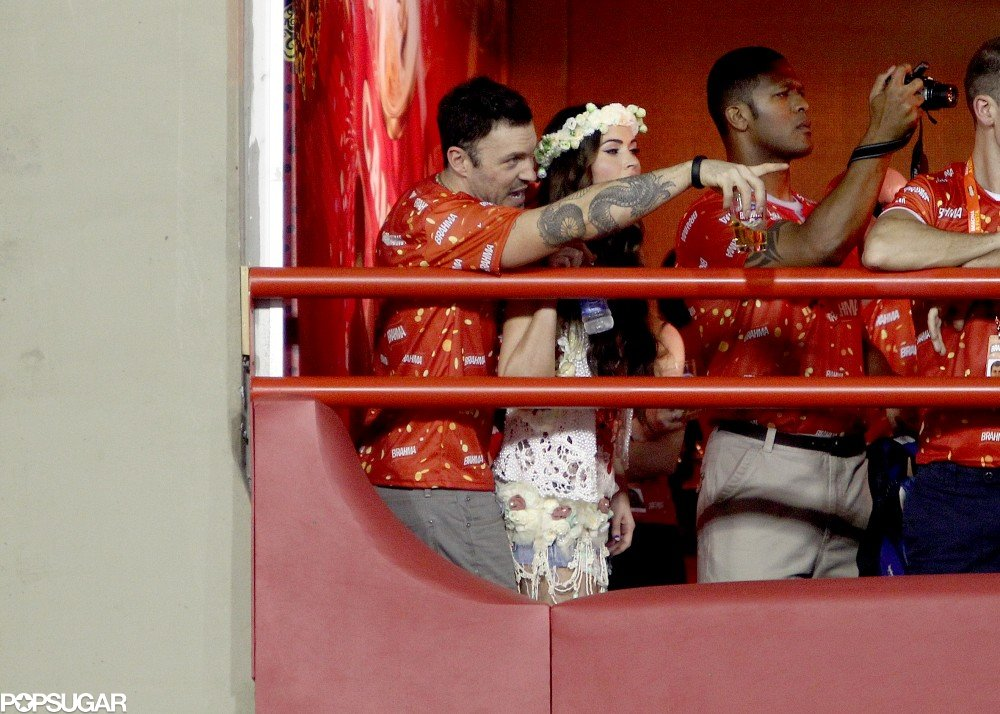 Megan Fox and Brian Austin Green hugged as they watched the parades for Carnival in Brazil.
